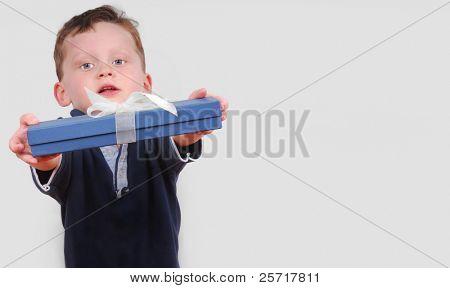 Boy Offering a Pretty Present