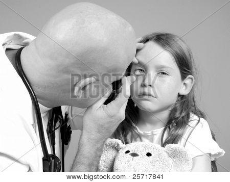Physician Examining Girl's Eye