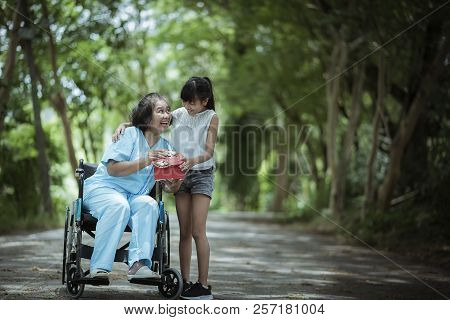 Asian Senior Or Elderly Old Woman Patient With Happy And Smile  When Get Giving A Gift  From Grandda