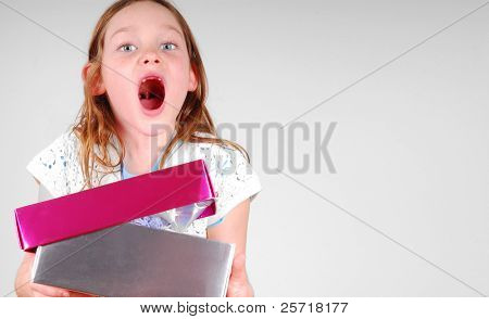 Young girl very happy while opening pretty gift box