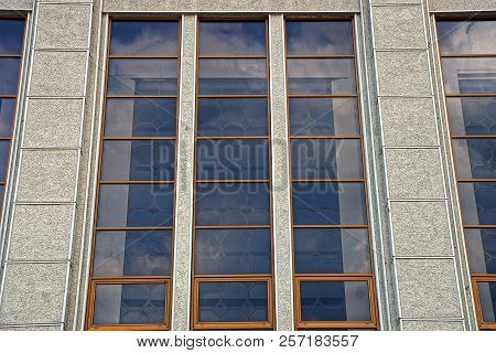Large Glass Brown Window On A Gray Concrete Wall