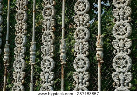 Texture Of Metal From Gray Rods In A Forged Pattern And A Grid On A Fence