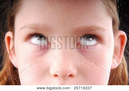 Freckle faced girl rolling eyes in reaction