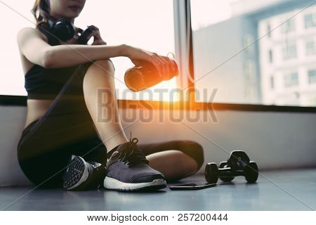 Woman Exercise Workout In Gym Fitness Breaking Relax Holding Protein Shake Bottle After Training Spo