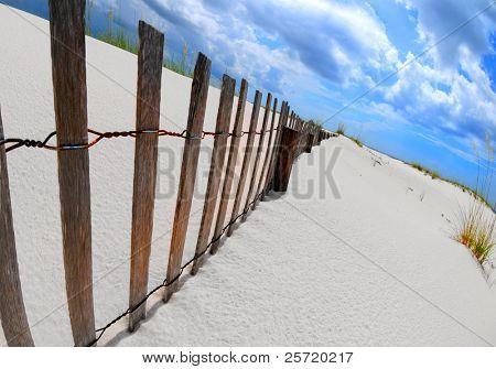 Sand dune fence stretching over beautiful coastal area