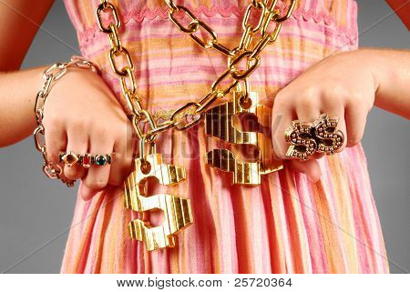Young girl wearing gaudy hip hop jewelry