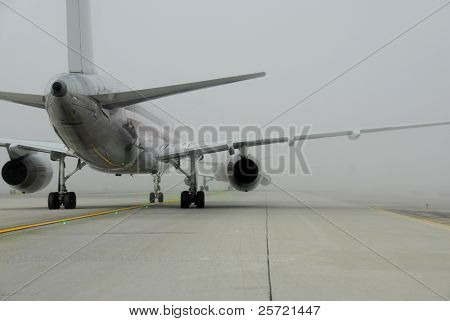 Plane in line for takeoff during fog