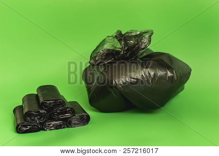 Stacked Black Bags And Bagged Trash. Take Out The Garbage