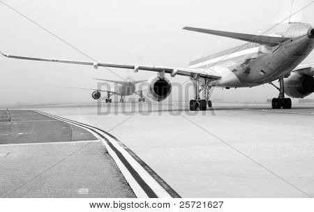 Aircraft lined up to take off in foggy conditions