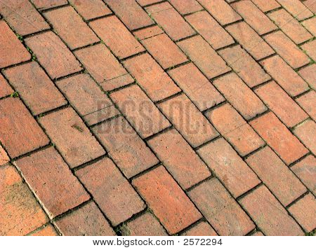 Modern red cobblestones paving abstract close up. poster