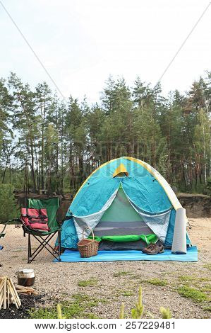 Camping Tent And Accessories In Wilderness On Summer Day