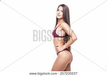 Sexy Busty Young Brunette Woman In A Bikini Isolated On White Background