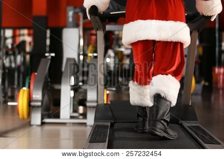 Authentic Santa Claus Training On Treadmill In Modern Gym, Focus On Legs
