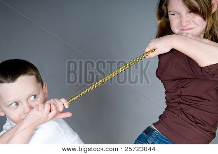 young chiildren in fight over beads