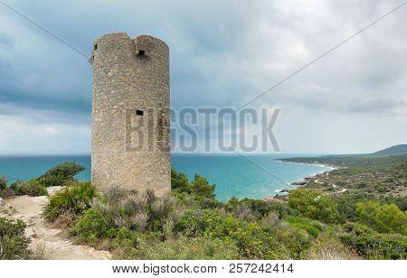 Watchtower On The Cliff In The Sea. Sierra De Irta In Peniscola. Castellon. Spain.