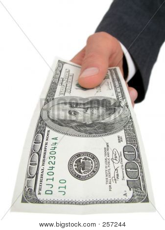 Businessman's Hand Offering Money