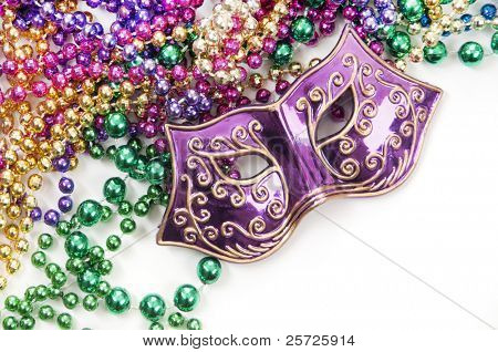 Mardi gras mask and beads in pile poster