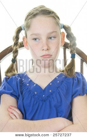 young girl upset in chair