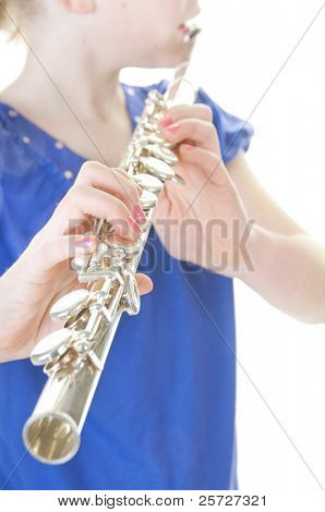 young girl playing flute instrument