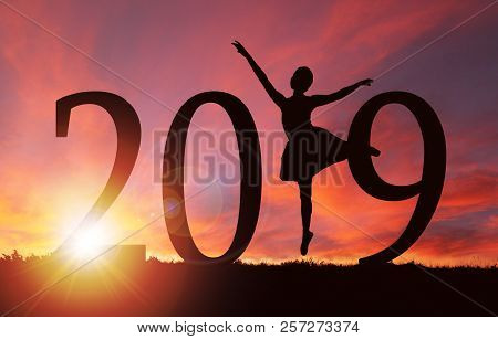 2019 New Year Silhouette Of A Girl Dancing Or Exercising During Golden Sunrise Or Sunset With Copy S