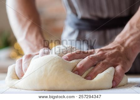 Breadmaking Recipe. Food Preparing And Culinary Skills Concept. Man Hands Kneading Dough.