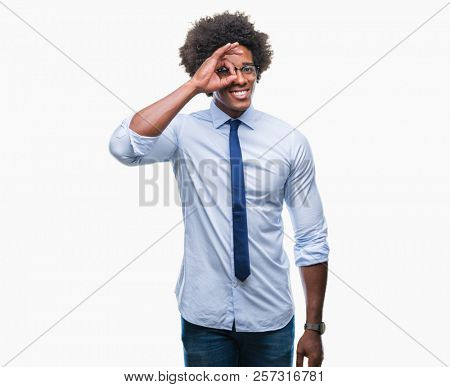 Afro american business man wearing glasses over isolated background doing ok gesture with hand smiling, eye looking through fingers with happy face.