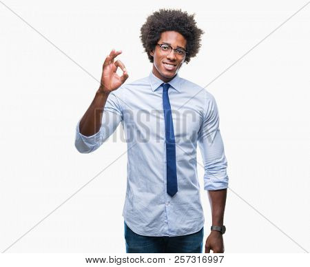 Afro american business man wearing glasses over isolated background smiling positive doing ok sign with hand and fingers. Successful expression.