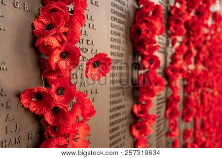 Canberra, Act, Australia - Sept 1 2018: Poppy Decoration Next To The Wall Of Fallen Soldiers At The