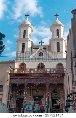 Facade Of A Small Coptic Church With A Wooden Column Porch In The Christian Quarter Of Cairo With Tw