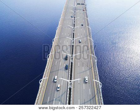 Aerial View Of Highway In The Ocean. Cars Crossing Bridge Interchange Overpass. Highway Interchange