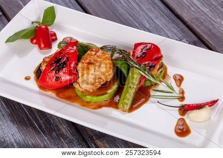 Vegetables And Chicken Grilled With Sauce On A Plate