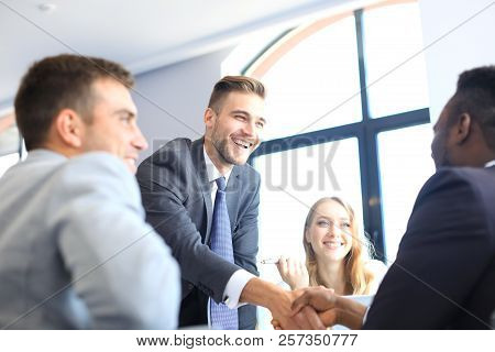 Business People Shaking Hands During A Meeting.