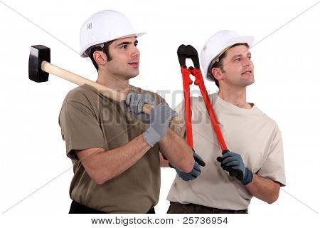 Two manual workers stood together