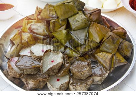 Chinese sweetmeat steamed dessert in banana leaf basket for celebration in Chinese New Year and Chinese Ghost Festival for ancestral worship. Favourite sweet dessert for ceremony. poster
