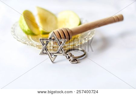 Rosh Hashanah Jewish New Year Concept Image. Apples With Honey And Wooden Honey Stick On A Plate And