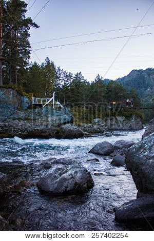 Forest Wild River Landscape. River Cascading Stream In A Mountain Forest. River Panorama Of A Mounta