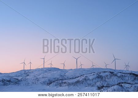 View At The Wind Turbines Farm In Norway In Winter. Wind Power Engineering In Scandinavian Countries