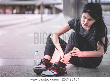 Sport Woman Is Having An Injury On Her Ankle Foot