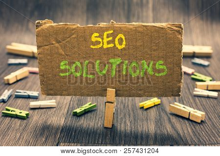 Writing Note Showing Seo Solutions. Business Photo Showcasing Search Engine Result Page Increase Vis