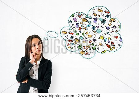 Thoughtful Young Businesswoman With Creative Business Thought Cloud Sketch. Think And Idea Concept