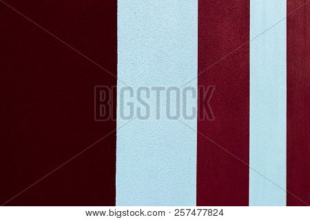 Red And White Striped Painted Wall At An Angle