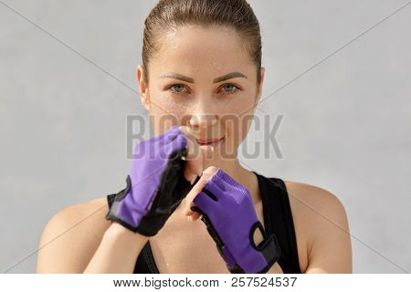 Sport, Boxing And People Concept. Sweat Self Determined Fit Young Woman Wears Special Gloves, Goes I