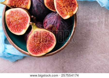 Fresh Figs. Whole Figs And Sliced In Half Figs In Ceramic Bowl. Top View, View From Above. With Blue