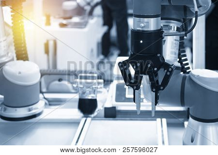 The Robot Arm Catch  For Electronic Assembly Line. The Robot For Hi-technology  Manufacturing Proces