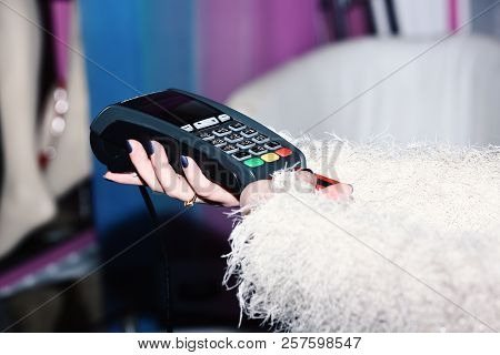 Female Hand Puts Bankcard Into Reader On Defocused Background. Payment With Credit Card. Edc Machine