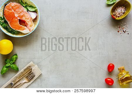 Food Frame Of Uncooked Salmon Steak And Ingredients For Cooking. Flat Lay