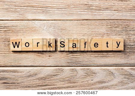 Work Safety Word Written On Wood Block. Work Safety Text On Table, Concept.