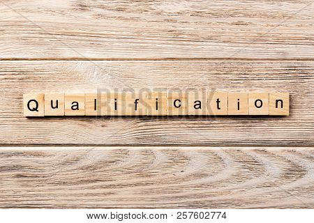 Qualification Word Written On Wood Block. Qualification Text On Table, Concept.