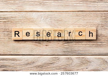Research Word Written On Wood Block. Research Text On Table, Concept.