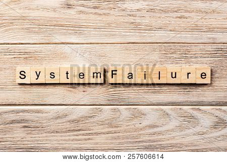 System Failure Word Written On Wood Block. System Failure Text On Table, Concept.